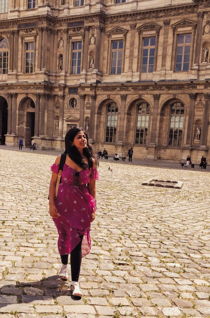 Louvre museum courtyard in Paris - majestic and beautiful even without Mona Lisa or the Pyramid in view.