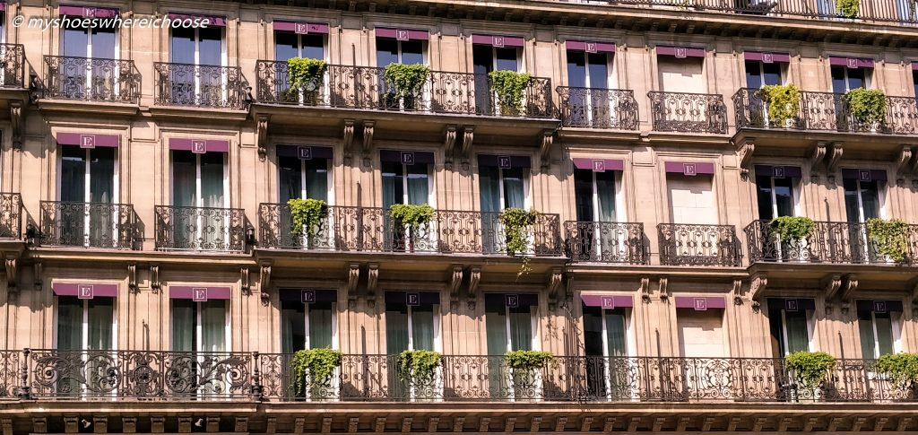 Parisian apartments with pretty plants on their balconies.