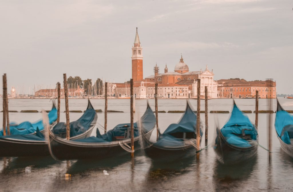 Gondolas at Venice swaying in the water