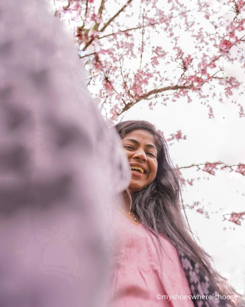 Selfie with a tripod to show spring blossoms above me